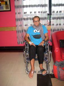 En chaise roulante